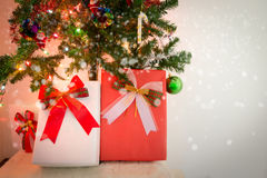 Christmas gift box and decorated Christmas tree with snow effect Royalty Free Stock Photos