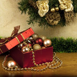 Christmas gift box with decoration. Christmas still life with color balls and gift box Stock Photos