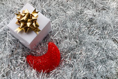 Christmas gift box and decoration on white fir Stock Photo