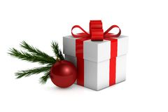 Christmas gift box with decorations and branch fir tree. On a white background Stock Photos