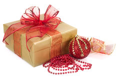 Christmas Gift Box and Decorations in Gold and Red Stock Image