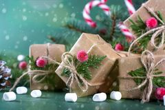 Christmas gift box and decorations. Old fashion style. On green bright background Stock Photos