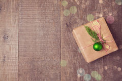 Christmas gift box with decorations on wooden background. View from above with copy space Royalty Free Stock Images