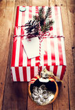 Christmas gift box and decorations on wooden background. Vintage Stock Photo