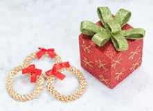 Christmas gift box and decorative straw wreath. Royalty Free Stock Photography