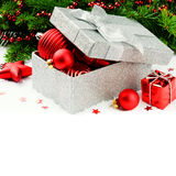 Christmas gift box with festive decorations Stock Images