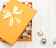 Christmas gift box filled with silver baubles Stock Image