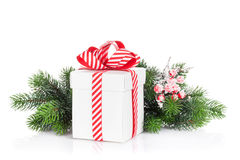 Christmas gift box and fir tree branch royalty free stock images