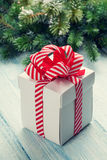 Christmas gift box and fir tree Stock Photo
