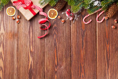 Christmas gift box, food decor and tree branch Stock Photo