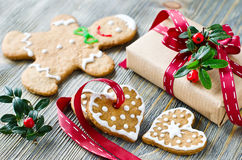 Christmas gift box and gingerbread cookies on wooden background stock photos