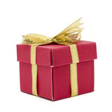 Christmas gift box with a gold ribbon bow Royalty Free Stock Photography