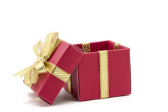christmas gift box with a gold ribbon bow Royalty Free Stock Images