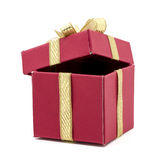Christmas gift box with a gold ribbon bow Royalty Free Stock Photo