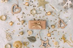 Christmas gift box with golden background stock image