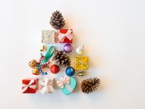 Christmas gift box,golden glister ball and pine cone in tree sha Royalty Free Stock Image