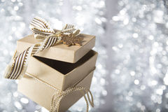 Christmas gift box with golden star Stock Photos