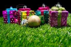 Christmas gift box on grass