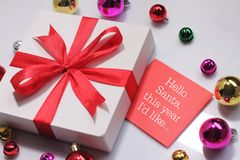 Christmas gift box with greeting card. Wishing you wonderful memories during this joyous season Stock Images