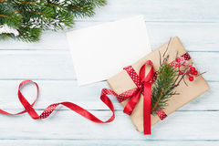 Christmas gift box and greeting card. On wooden background. Top view with copy space Stock Photography