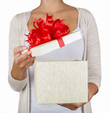 Christmas gift box with hand open Royalty Free Stock Photo