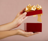 Christmas gift box with hand open Stock Photos
