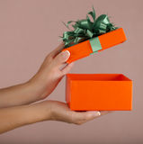Christmas gift box with hand open Stock Images