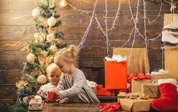 Christmas gift box and happy family. Kids opening Xmas presents. Winter evening at home. Happy smiling child with stock images