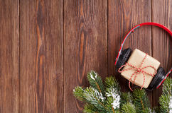 Christmas gift box with headphones and tree branch Royalty Free Stock Photography