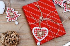 Christmas gift box with heart shaped decoration Royalty Free Stock Photo