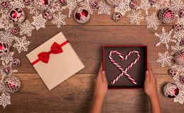 Christmas gift box inside seasonal decorations frame Royalty Free Stock Photography