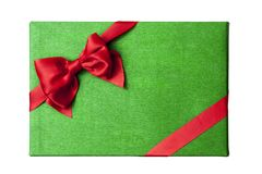 Christmas gift box lid top view. Green wrapping paper box with red satin ribbon and bow. White background isolated Royalty Free Stock Photos