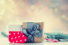 Christmas gift box and little sock Royalty Free Stock Images