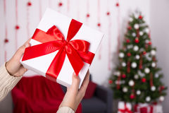 Christmas gift box in male hands. Close up of christmas gift box in male hands Royalty Free Stock Photo