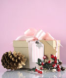 Christmas gift box in modern trend natural gift wrapping - vertical with copy space. Royalty Free Stock Photo