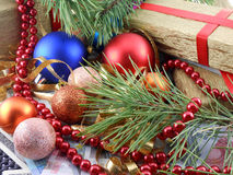 Christmas gift box with new year balls, diamonds and tree branch Royalty Free Stock Photography