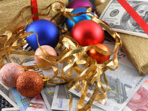 Christmas gift box with new year balls and money Royalty Free Stock Photography