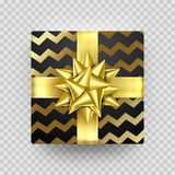 Christmas gift box New Year present in golden ribbon bow and wrapping paper wave foil gold pattern. Round gift box for Birthday or. Christmas holiday greeting Royalty Free Stock Images