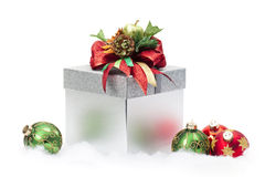 Christmas Gift Box & Ornaments. Christmas gift box with ornaments around it stock photo