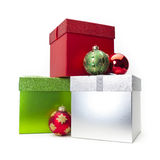 Christmas Gift Box & Ornaments. Christmas gift box with ornaments around it royalty free stock image