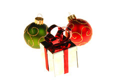 Christmas gift box with ornaments around it. Isolated on white Stock Images
