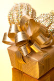 Christmas gift box and ornaments on golden background Stock Photo