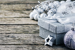 Christmas gift box and ornaments in silver tone Stock Photo