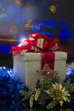 Christmas Gift Box over colored background Royalty Free Stock Images