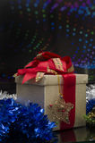 Christmas Gift Box over colored background Stock Images