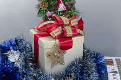 Christmas Gift Box over grey background Stock Photo