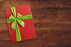 Christmas gift box over wooden background Stock Photography