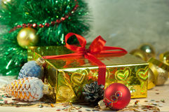 Christmas gift box with pine cones and balls Stock Photo