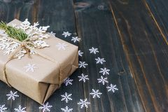 Christmas gift box placed and white snowflakes on wooden planks royalty free stock photo