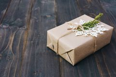 Christmas gift box placed and white snowflakes on wooden planks stock image